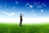 10627025-young-businessman-outdoor-with-business-symbols-on-the-sky-background